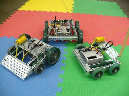 "on the right, a standard two-motor, four wheel drive robot.  In the back, a four-motor, four wheel drive robot.  Since there is nothing linking the front and rear wheels together, when one wheel loses contact with the ground, the motor attached to it is no longer helping to push.  On the left a robot with two different diameter wheels... but with the same gearing leading to each wheel.  This is a common ""rookie mistake"" as the two wheels will have the same rotational velocities, but different circumferences, meaning each wheel will want to travel at a different speed.  Note the front ""omni-wheels"", which allow for easier turning... a factor that becomes more important as the robots get bigger and heavier."